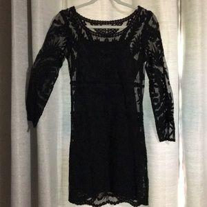 Black lace cocktail dress.